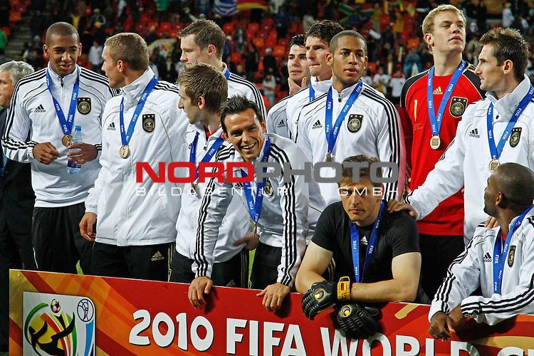 The German team after the FIFA World Cup 2010 3rd Place Play off match between Uruguay and Germany held at The Nelson Mandela Bay Stadium  in Port Elizabeth, South Africa on the 10 July 2010<br /> <br /> <br />  <br /> <br /> Foto &copy;  nph /  Kokenge *** Local Caption *** Fotos sind ohne vorherigen schriftliche Zustimmung ausschliesslich f&uuml;r redaktionelle Publikationszwecke zu verwenden.<br /> <br /> Auf Anfrage in hoeherer Qualitaet/Aufloesung
