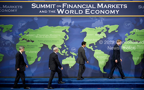 Washington, DC - November 15, 2008 -- World leaders walk on stage for a group photo at the start of the Summit on Financial Markets and the World Economy at the National Building Museum in Washington, D.C., USA, 15 November 2008. The leaders of 20 countries are in attendance. .Credit: Matthew Cavanaugh - Pool via CNP