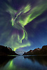 "A very powerful auroa over the fjord Ersfjordbotn, close to Tromsø, on sept.5th,2012. This special aurora has a shape which reminds of a dragon. The head of the dragon is made by a ""coronal aurora"".<br />