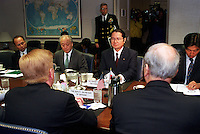 Feb. 16, 2001, Washington, DC, United States<br /> <br /> Japanese Senior Vice Minister of Foreign Affairs Seishiro Eto (right) and Ambassador to the U.S. Shunji Yanai (left) meet in the Pentagon with Deputy Secretary of Defense Rudy de Leon (left foreground) on Feb. 16, 2001, to discuss the February 9th collision of the submarine USS Greeneville and the Japanese fishing vessel Ehime Maru.  <br /> .<br /> <br /> Mandatory Credit: Photo by DoD photo by R. D. Ward.