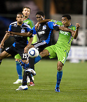 James Riley of Sounders fights for a loose ball against Khari Stephenson of Earthquakes during the game at Buck Shaw Stadium in Santa Clara, California on April 2nd, 2011.   San Jose Earthquakes and Seattle Sounders are tied 2-2.