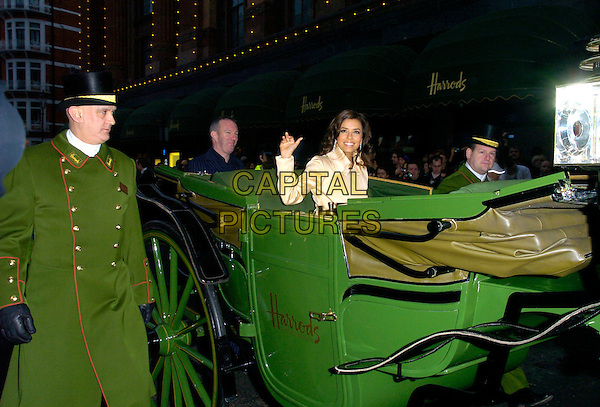 EVA LONGORIA.opens Harrods Winter Sale, Knightsbridge,.London, England, 28th December 2006..half length hand waving carriage green arriving footman hat uniform.CAP/CAN .©Can Nguyen/Capital Pictures