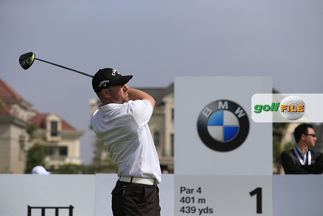 Craig Lee (SCO) tees off the 1st tee to start his match during Saturday's Round 3 of the 2013 BMW Masters presented by SRE Group held at Lake Malaren Golf Club, Shanghai, China. 26th October 2013.<br /> Picture: Eoin Clarke/www.golffile.ie