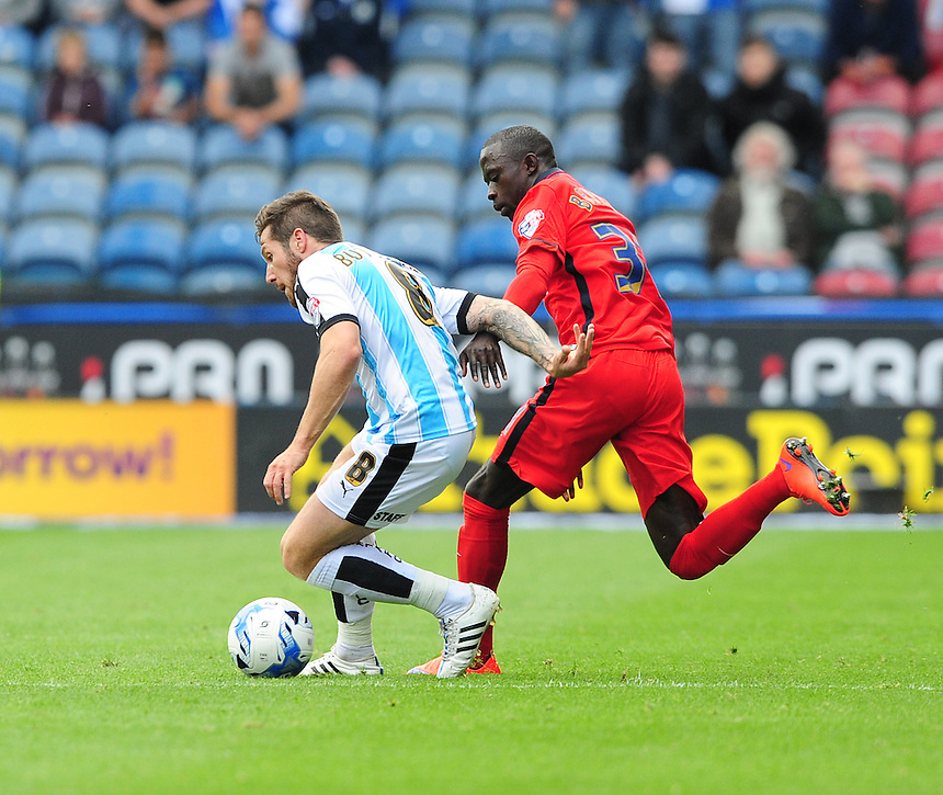 Huddersfield Town's Jacob Butterfield shields the ball from Blackburn Rovers&rsquo; Modou Barrow<br /> <br /> Photographer Chris Vaughan/CameraSport<br /> <br /> Football - The Football League Sky Bet Championship - Huddersfield Town v Blackburn Rovers - Saturday 15th August 2015 - The John Smith's Stadium - Huddersfield<br /> <br /> &copy; CameraSport - 43 Linden Ave. Countesthorpe. Leicester. England. LE8 5PG - Tel: +44 (0) 116 277 4147 - admin@camerasport.com - www.camerasport.com