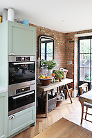 Detail of the open-plan kitchen/dining area in the extension of Kally Ellis's London home