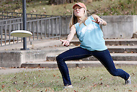 NWA Democrat-Gazette/DAVID GOTTSCHALK  Elise Franke, a senior at the University of Arkansas, makes a forehand throw with a flying disc Monday, November 2, 2015 on the campus in Fayetteville. Franke is the captain of the University women's club team that will be participating in the 25th annual Harvest Moon Ultimate Tournament taking place Saturday and Sunday hosted by the Fayetteville Disc Association with mens and women's open and college divisions.