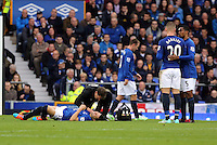 Liverpool, UK. Saturday 01 November 2014<br /> Pictured: Gareth Barry of Everton injured on the ground.<br /> Re: Premier League Everton v Swansea City FC at Goodison Park, Liverpool, Merseyside, UK.