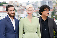 "Jake Gyllenhaal, Tilda Swinton and Bong Joon-ho at the ""Okja"" photocall during the 70th Cannes Film Festival at the Palais des Festivals on May 19, 2017 in Cannes, France. Credit: John Rasimus /MediaPunch ***FOR USA ONLY***"