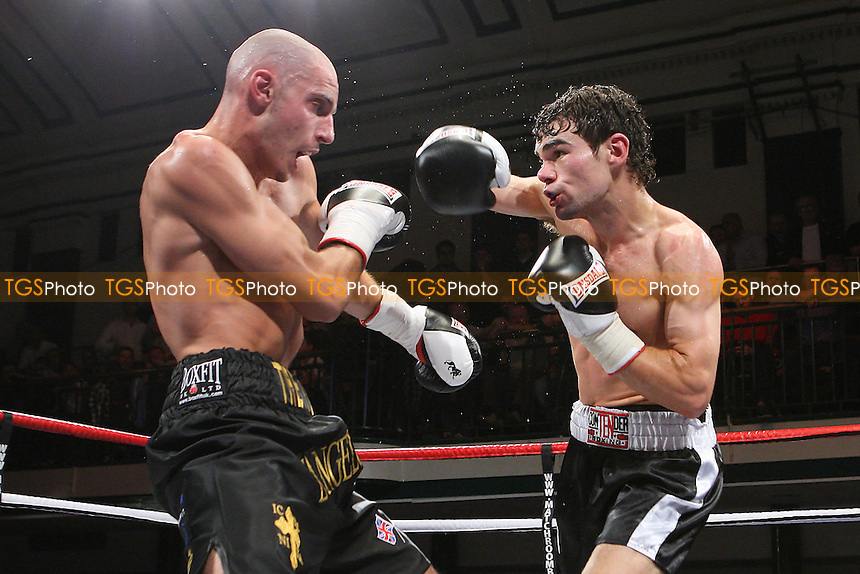 Chris Evangelou (black/gold shorts) defeats Joel Ryan in a Light-Welterweight boxing contest at York Hall, Bethnal Green, promoted by Matchroom Sports - 09/11/11 - MANDATORY CREDIT: Gavin Ellis/TGSPHOTO - Self billing applies where appropriate - 0845 094 6026 - contact@tgsphoto.co.uk - NO UNPAID USE.