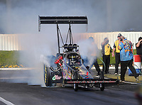 Feb. 14, 2013; Pomona, CA, USA; NHRA top fuel dragster driver Steve Chrisman during qualifying for the Winternationals at Auto Club Raceway at Pomona.. Mandatory Credit: Mark J. Rebilas-