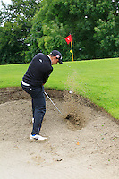Alan Lowry (Esker Hills) plugged in a bunker on the 2nd during round 1 of The Mullingar Scratch Cup in Mullingar Golf Club on Sunday 3rd August 2014.<br /> Picture:  Thos Caffrey / www.golffile.ie