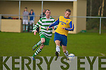 Classic FC's Darren Lynch gets away from Listowel Celtic's Eddie Joe Walsh in the Munster junior cup at Mounthawk park, Tralee on Sunday.