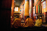 As we entered the main assembly hall at the Gongkar Chöde Monastery, the familiar smell of yak butter candles and the melodic sound of monks at prayer greeted us. Several generations of monks sat cross-legged on padded benches appearing only mildly distracted by the flashes of a dozen camera-clicking onlookers.