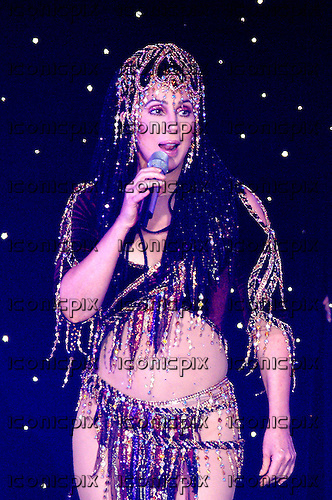 CHER - performing live in concert on her Farewell Tour at Wembley Arena in London UK - 22 May 2004.  Photo by: George Chin/IconicPix