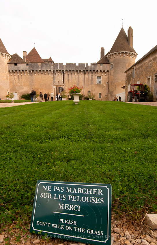 The medieval Chateau de Rully in Cote Chalonnaise, Bourgogne. Sign: don't walk on the grass.
