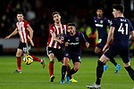 Chris Basham of Sheffield United challenges Manuel Lanzini of West Ham United during the Premier League match at Bramall Lane, Sheffield. Picture date: 10th January 2020. Picture credit should read: James Wilson/Sportimage