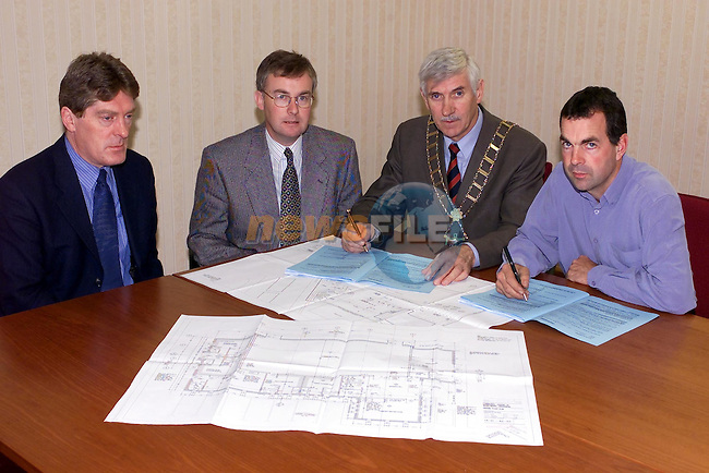 Peter Byrne National Building Agency, des Foley Town Clerk, Mayor Jiummy Mulroy and Builder Eamon Murphy signing the Contracts For the new Drogheda Amature Boxing Club and Community Facalities...Picture Fran Caffrey Newsfile.