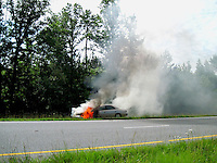 Car On Fire Toyota Camry By Jonathan Green