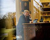 US President Donald Trump speaks with the King of Saudi Arabia, Salman bin Abd al-Aziz Al Saud in the Oval Office of the White House, January 29, 2017, Washington, DC. <br /> Credit: Aude Guerrucci / Pool via CNP