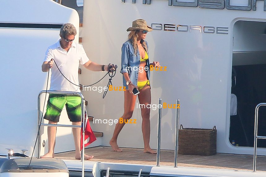 EXCLUSIVE - Supermodel Elle McPherson and husband Jeffrey Soffer enjoy some vacation aboard a mega yacht in Monte-Carlo. <br /> France, Monte-Carlo, 11 July 2015.