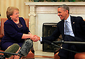 United States President Barack Obama, right, shakes hands with President Michelle Bachelet Jeria of Chile, left, in the Oval Office of the White House in Washington, D.C. on June 30, 2014.<br /> Credit: Dennis Brack / Pool via CNP