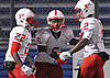 Elyjah Campbell #6 of Freeport, center, gets congratulated by Jahred Wray #22, left, and Aaje Grayson #2 after rushing for a touchdown in the Nassau County varsity football Conference I final against Farmingdale at Hofstra University on Thursday, Nov. 17, 2016.