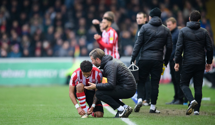 Lincoln City's assistant manager Nicky Cowley speaks to Lincoln City's Bruno Andrade during a break in play<br /> <br /> Photographer Chris Vaughan/CameraSport<br /> <br /> The EFL Sky Bet League Two - Lincoln City v Mansfield Town - Saturday 24th November 2018 - Sincil Bank - Lincoln<br /> <br /> World Copyright © 2018 CameraSport. All rights reserved. 43 Linden Ave. Countesthorpe. Leicester. England. LE8 5PG - Tel: +44 (0) 116 277 4147 - admin@camerasport.com - www.camerasport.com
