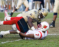 Pitt linebacker H.B. Blades (51) gives Louisville Cardinals wide receiver Mario Urrutia (7) a push.  The Louisville Cardinals defeated the Pitt Panthers 48-24 on November 25, 2006 at Heinz Field, Pittsburgh, Pennsylvania.