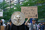 "George Washington Coin head, and ""Give me back my future!"" sign at the Occupy Wall Street Protest in New York City October 6, 2011."
