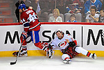31 March 2010: Montreal Canadiens' defenseman Roman Hamrlik checks Carolina Hurricanes' left wing forward Erik Cole during the second period at the Bell Centre in Montreal, Quebec, Canada. The Hurricanes defeated the Canadiens 2-1 in their last meeting of the regular season. Mandatory Credit: Ed Wolfstein Photo