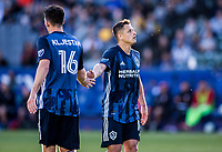 """CARSON, CA - FEBRUARY 15: Sacha Kljestan #16 and Javier """"Chicharito"""" Hernandez #14 of the Los Angeles Galaxy slap hands together during a game between Toronto FC and Los Angeles Galaxy at Dignity Health Sports Park on February 15, 2020 in Carson, California."""