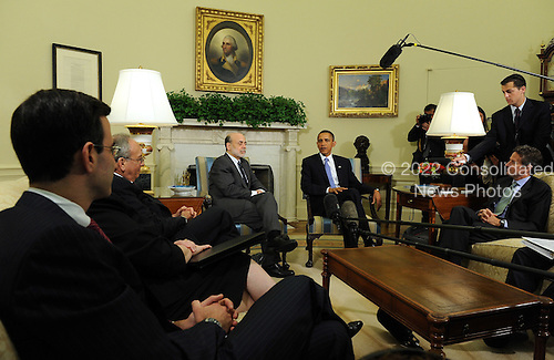 United States President Barack Obama speaks to the media after meeting with Federal Reserve Board Chairman Ben Bernanke (CL) in the Oval Office of the White House in Washington on Tuesday, June 29, 2010. With them are outgoing Office of Management and Budget Director Peter R. Orszag (L) and Treasury Secretary Timothy Geithner (R).   .Credit: Roger L. Wollenberg - Pool via CNP