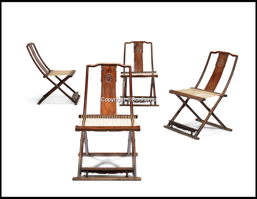 BNPS.co.uk (01202 558833)Pic: Bonhams/BNPS<br /> <br /> The vendor may have needed to sit down after these four humble looking wooden chairs sold for over £5 million at Bonhams this week.<br /> <br /> The seller of this set of four Chinese chairs will need a sit down after they sold for a whopping £5.3million.<br /> <br /> The incredibly rare set of Huanghuali folding chairs are considered a masterpiece of Ming Dynasty furniture and were tipped to sell for £150,000.<br /> <br /> But after a fierce bidding war in a packed saleroom at Bonhams in London they sold for more than 35 times that - £5,296,500.<br /> <br /> The chairs, which are the only known version of this form and type, were owned by distinguished Italian diplomat Francesco Maria, Marchese Taliani de Marchio, and his wife Maragaretha, the Archduchess d'Austria Toscana.
