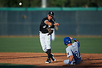 AZL White Sox second baseman Jose Rodriguez (5) throws to first base over Jimmy Govern (8) during an Arizona League game against the AZL Royals at Camelback Ranch on June 19, 2019 in Glendale, Arizona. AZL White Sox defeated AZL Royals 4-2. (Zachary Lucy/Four Seam Images)