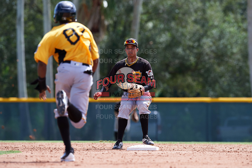 Pittsburgh Pirates shortstop Adrian Valerio (59) waits for a throw as Kevin Sanchez (87) runs to second base during an Instructional League Intrasquad Black & Gold game on September 28, 2016 at Pirate City in Bradenton, Florida.  (Mike Janes/Four Seam Images)