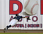 Reno Aces' Tony Campana dives for a ball during a Triple-A baseball game against the Las Vegas 51s in Reno, Nev., on Sunday, July 21, 2013. The 51s won 15-8.<br /> Photo by Cathleen Allison