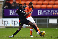 Blackpool's Clark Robertson competes in the air with Walsall's Amadou Bakayoko<br /> <br /> Photographer Richard Martin-Roberts/CameraSport<br /> <br /> The EFL Sky Bet League One - Blackpool v Walsall - Saturday 10th February 2018 - Bloomfield Road - Blackpool<br /> <br /> World Copyright &not;&copy; 2018 CameraSport. All rights reserved. 43 Linden Ave. Countesthorpe. Leicester. England. LE8 5PG - Tel: +44 (0) 116 277 4147 - admin@camerasport.com - www.camerasport.com