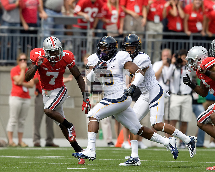C.J. Anderson of California runs the ball away from Ohio State defenders during the game at Ohio Stadium in Columbus, Ohio on September 15th, 2012.   Ohio State Buckeyes defeated California Bears, 35-28.