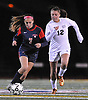 South Side No. 7 Ally Diez, left, gets pressured by Wantagh No. 12 Michele Smith during a Nassau County varsity girls' soccer Class A semifinal played at Cold Spring Harbor High School on Friday, October 30, 2015.<br /> <br /> James Escher