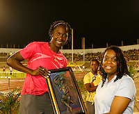 Kerron Stewart with her 1st. place award after winning the 100m dash with a time of 10.92sec. at the Jamaica International Invitational Meet on May 2nd. 2009. Photo by Errol Anderson,The Sporting Image.net