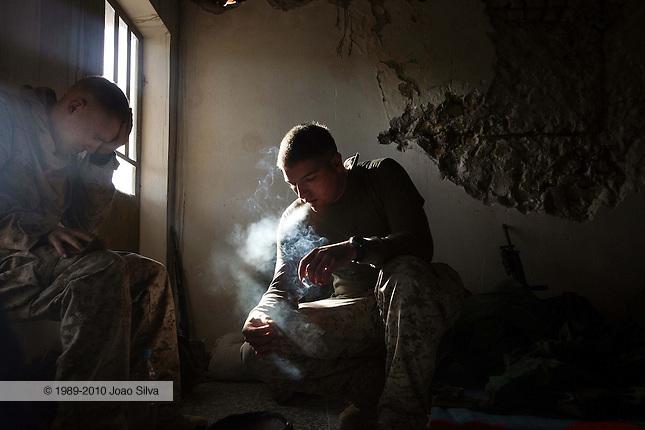 Iraq: Zagarit: November 9, 2006: LCPL James L. Davis jr (right) of the 3rd Squad, 3rd Platoon, Fox Company 2nd Battalion 8th Marines takes a smoke break after standing guard.