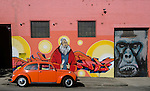 Orange VW Beetle in front of Street Art in St. Peters, Sydney, NSW, Australia