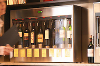 The interior of the wine bar Terrenos Vinotek. The machine that dispenses the doses of wine in a self service fashion. showing the selection of wines available.  Stockholm, Sweden, Europe