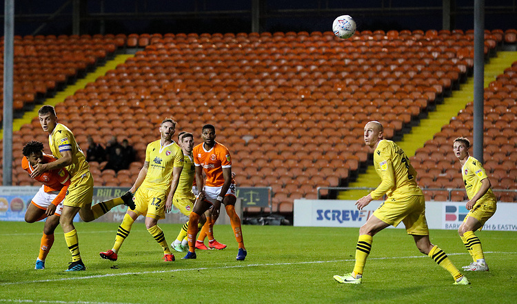 Blackpool's Joe Nuttall gets a header away, under pressure from Morecambe's Sam Lavelle<br /> <br /> Photographer Alex Dodd/CameraSport<br /> <br /> EFL Leasing.com Trophy - Northern Section - Group G - Blackpool v Morecambe - Tuesday 3rd September 2019 - Bloomfield Road - Blackpool<br />  <br /> World Copyright © 2018 CameraSport. All rights reserved. 43 Linden Ave. Countesthorpe. Leicester. England. LE8 5PG - Tel: +44 (0) 116 277 4147 - admin@camerasport.com - www.camerasport.com