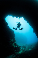 scuba diver and lava rock arch, Lanai, Hawaii, USA, Pacific Ocean, MR
