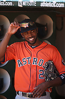 OAKLAND, CA - SEPTEMBER 7:  Dexter Fowler #21 of the Houston Astros smiles in the dugout before the game against the Oakland Athletics at O.co Coliseum on Sunday, September 7, 2014 in Oakland, California. Photo by Brad Mangin