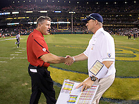 California head coach Jeff Tedford shakes hands with Utah head coach Kyle Whittingham after the game at AT&T Park in San Francisco, California on October 22, 2011.   California defeated Utah, 34-10.