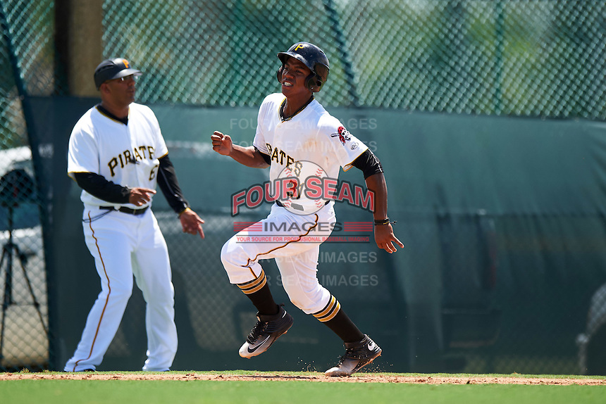 GCL Pirates first baseman Mikell Granberry (31) running the bases as manager manager Edgar Varela (6) directs during a game against the GCL Yankees East on August 15, 2016 at the Pirate City in Bradenton, Florida.  GCL Pirates defeated GCL Yankees East 5-2.  (Mike Janes/Four Seam Images)