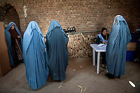 Afghan women arrive at a polling station in Kabul, Afghanistan, to cast their ballot in parliamentary elections /Felix Features