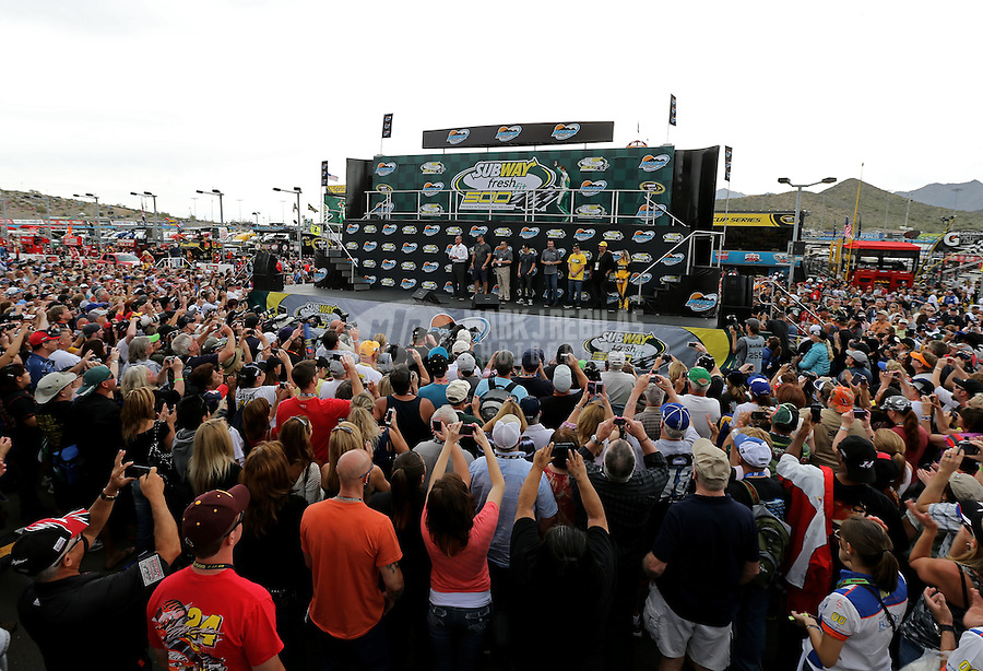 Mar. 3, 2013; Avondale, AZ, USA; NASCAR Sprint Cup Series fans surround the main stage during driver introductions prior to the Subway Fresh Fit 500 at Phoenix International Raceway. Mandatory Credit: Mark J. Rebilas-